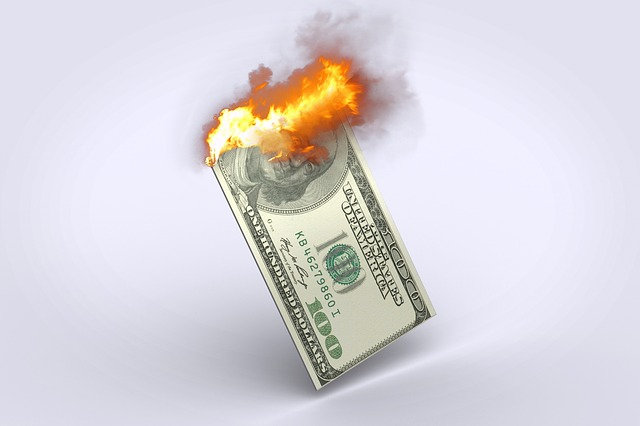 image shows burning dollar bill